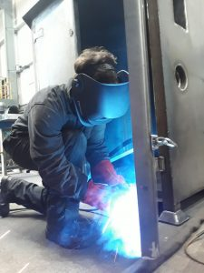 Sparks fly! Augustin welding a Water Bowser.