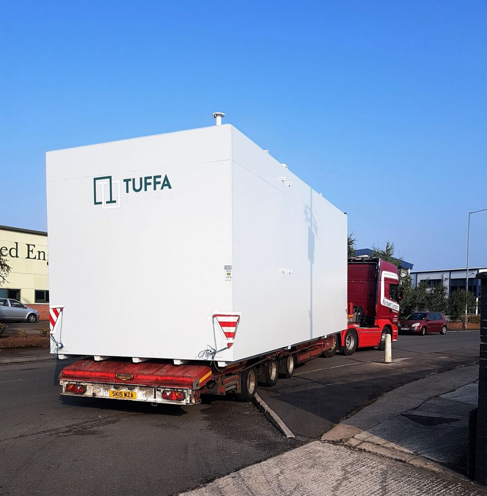 The 90,000 litre oil tank leaves the Tuffa yard.
