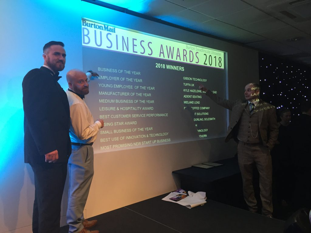 Name in lights. Jason and Mike pointing out Tuffa's Employer of the Year award